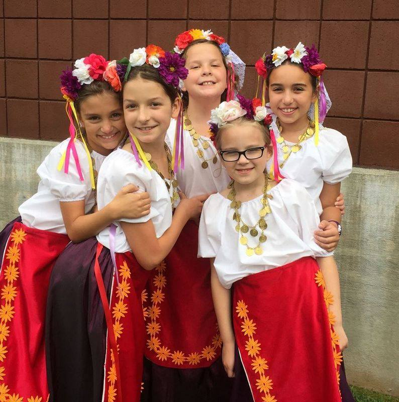 """<span  class=""""uc_style_uc_tiles_grid_image_elementor_uc_items_attribute_title"""" style=""""color:#ffffff;"""">Young dancers pose for a quick photo before dashing back on stage!</span>"""