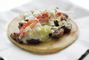 """<span  class=""""uc_style_uc_tiles_grid_image_elementor_uc_items_attribute_title"""" style=""""color:#ffffff;"""">Come grab an authentic Greek Gyro from the Greek Street Eats booth.</span>"""